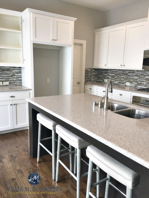Sherwin Williams Repose Gray in kitchen with white cabinets and warm gray toned quartz countertops. E-design and Colour Consultation by expert Kylie M Interiors