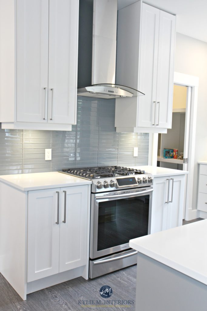 White shaker style cabinets, white quartz countertops, Coventry Gray island and Stonington Gray walls