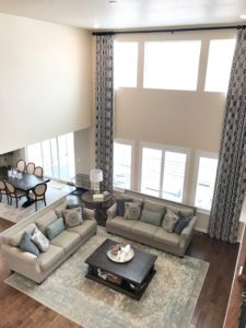 living room south facing, Navajo White Benjamn Moore greige furniture. Before Kylie M E-design