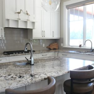 Kylie M Interiors Edesign, cloud white kitchen cabinets, granite countertop, glass subway tile backsplash. south facing. online consulting