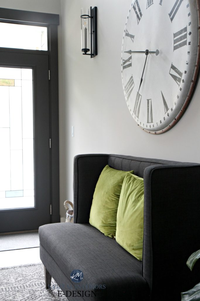 Entryway in Sherwin Williams Collonade Gray with oversized large clock, charcoal bench seat and foyer front door painted Urbane Bronze. Kylie M INteriors Edesign, online paint color expert - Copy