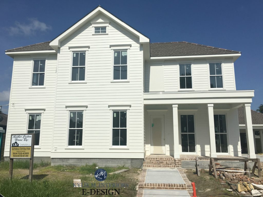 Exterior painted Benjamin Moore White Dove, brick steps and front porch, Weatherwood roof. Kylie M INteriors Edesign. Client photo