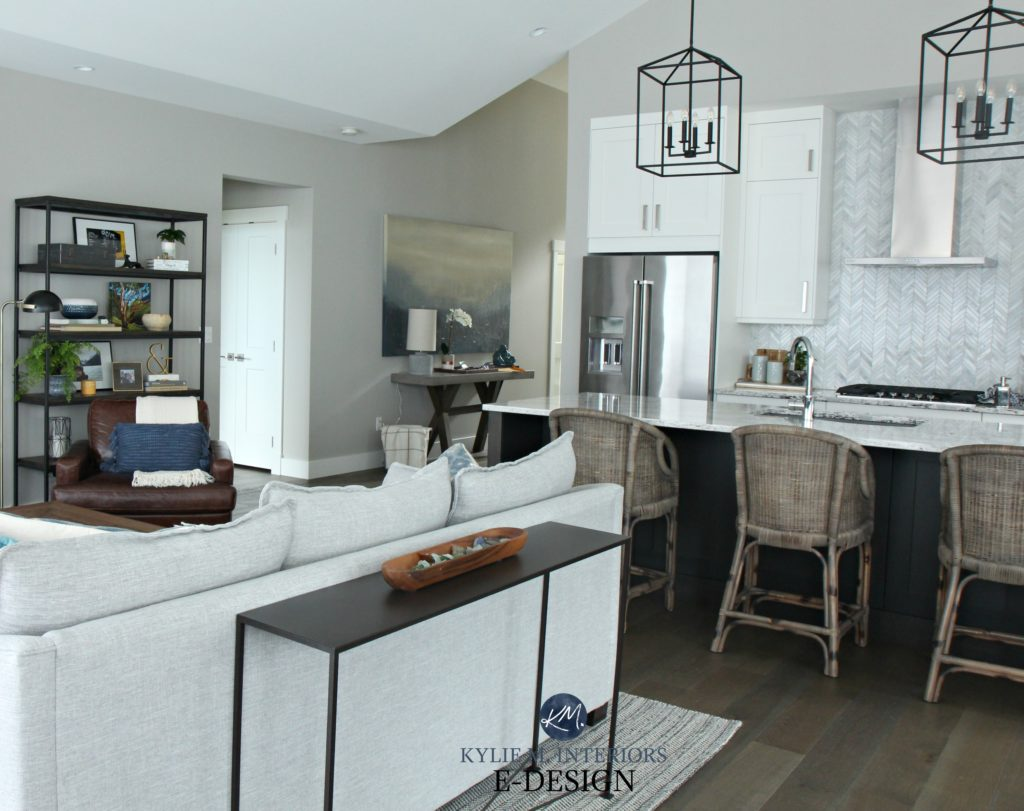 Open layout great room. Kylie M INteriors edesign. Sherwin Williams Collonade Gray. Transitional home decor and rattan bar stools - Copy