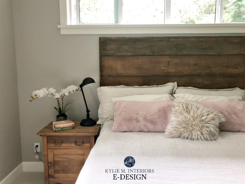 Bedroom Benjamin Moore Revere Pewter, best warm gray greige paint colour. Wood headboard, rose pink accents. Kylie M INteriors Edesign, online paint colour expert and decorating blog