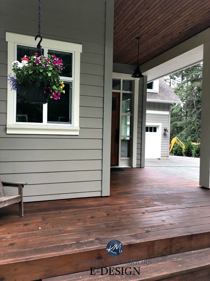 Benjamin Moore Rockport Gray exterior siding. Cloud White, wood deck and porch ceiling. Kylie M interiors edesign, online paint color expert consulting and decorating blog