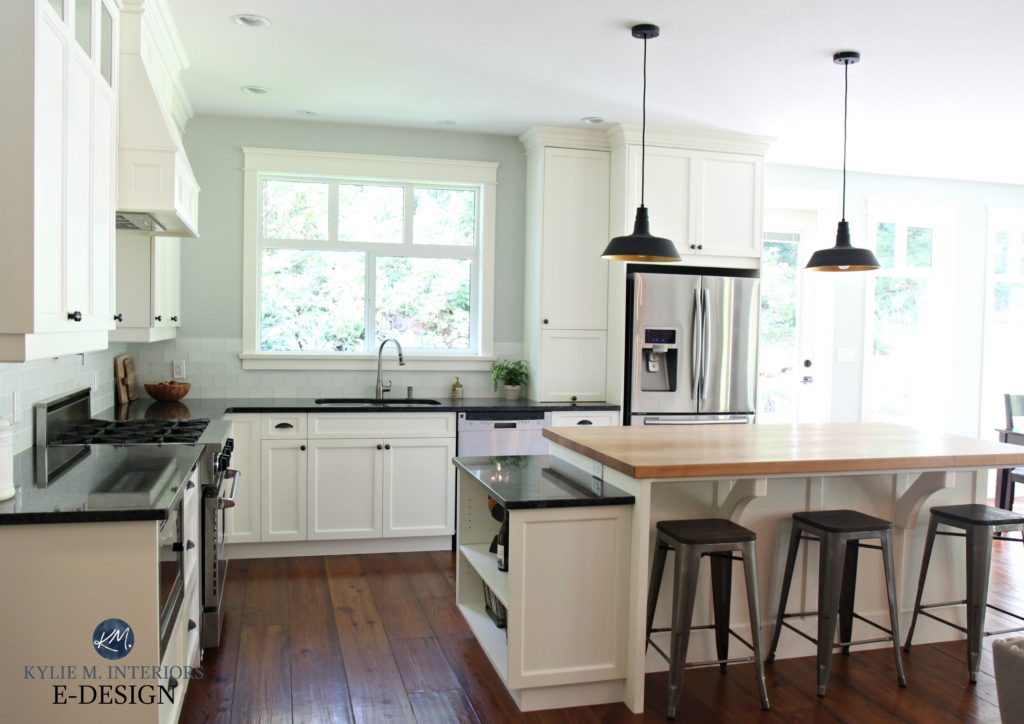 Country farmhouse style kitchen with Cloud Whtie cabinets, black granite, butcher block island. Benjamin Moore Gray Cashmere. Kylie M Interiors Edesign, online paint colour expert blog