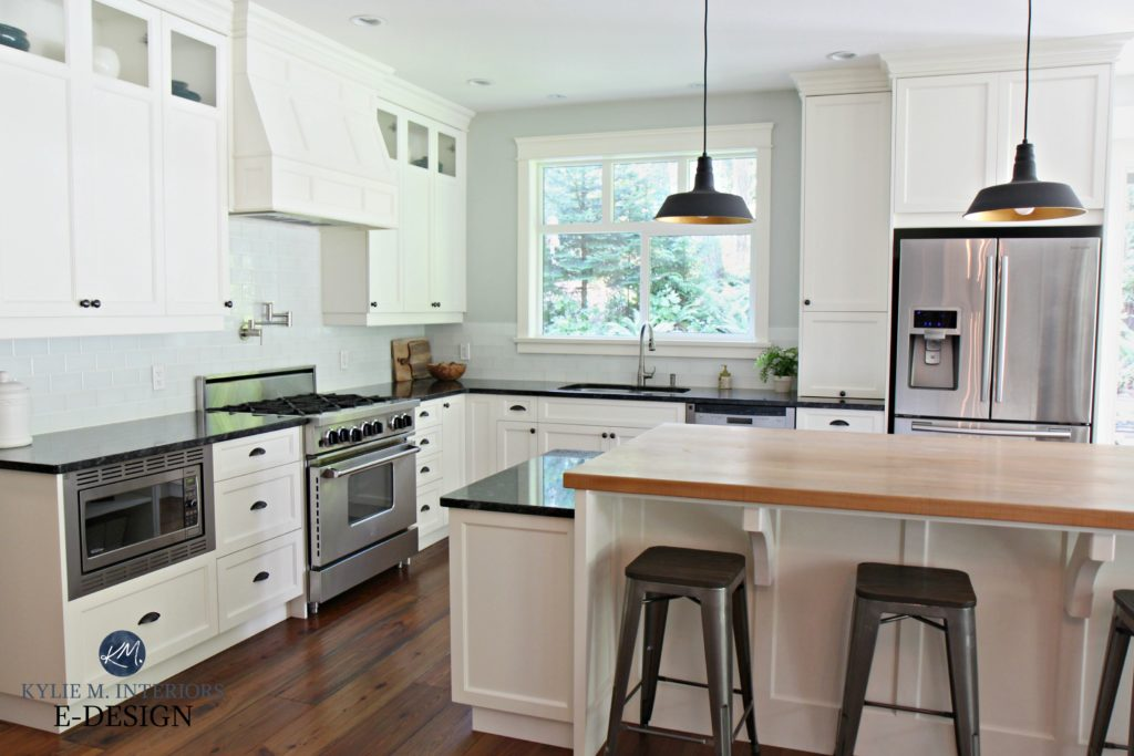 White Kitchen With Black Granite And Wood Floor