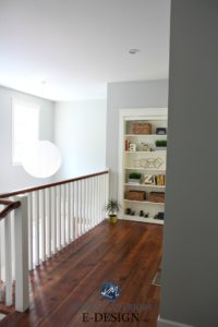 Hallway with reclaimed wood flooring and white railling. Benjamin Moore Gray Owl and built in bookcase. Kylie M Interiors Edesign, online paint color