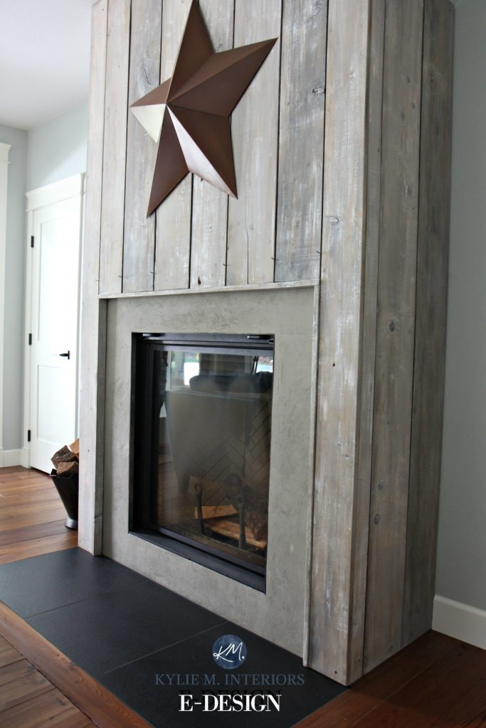 Rustic wood burning fireplace with reclaimed wood boards, slate hearth, concrete look surround. Gray Cashmere walls. Kylie M Interiors Edesign, client DIY
