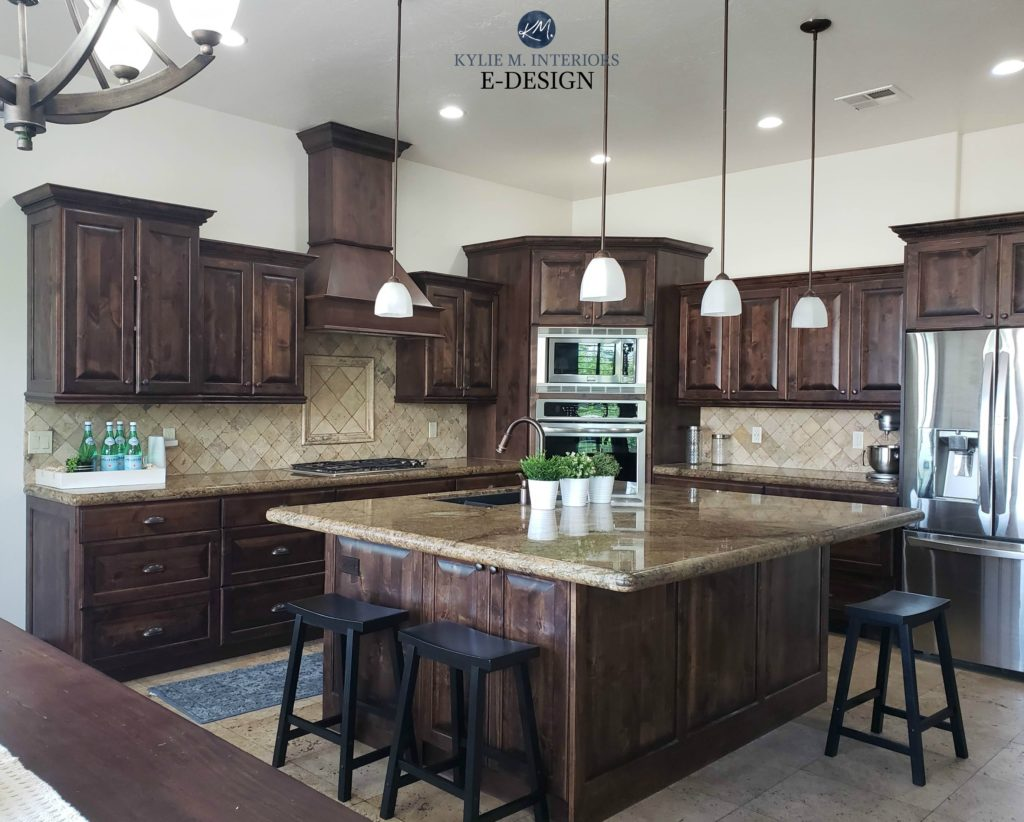 Dark wood kitchen cabinets and trim with travertine tile backsplash and warm granite. Sherwin Williams White Duck darkened on walls. Kylie M Interiors Edesign, online paint color advice blog