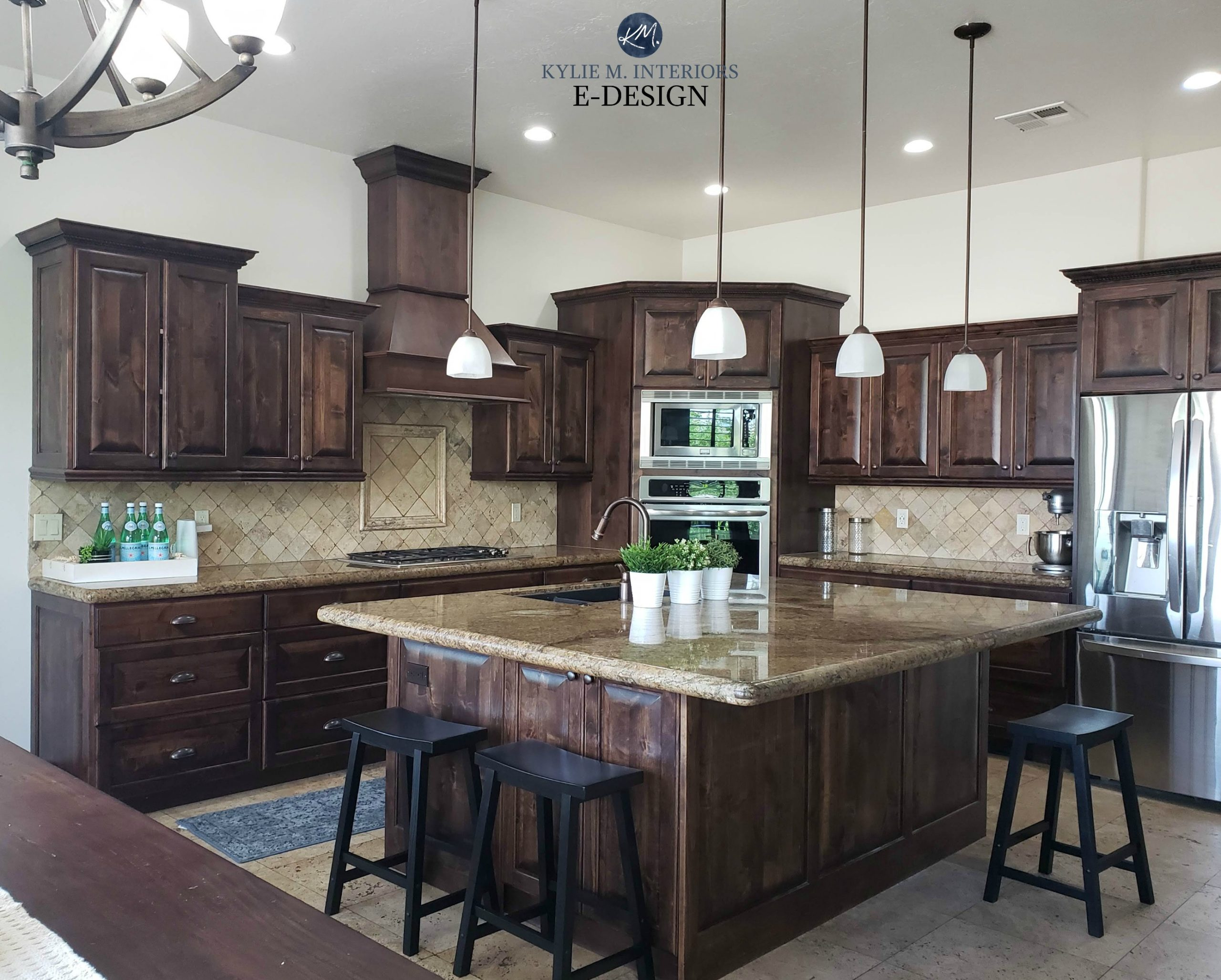 Dark wood kitchen cabinets and trim with travertine tile ...