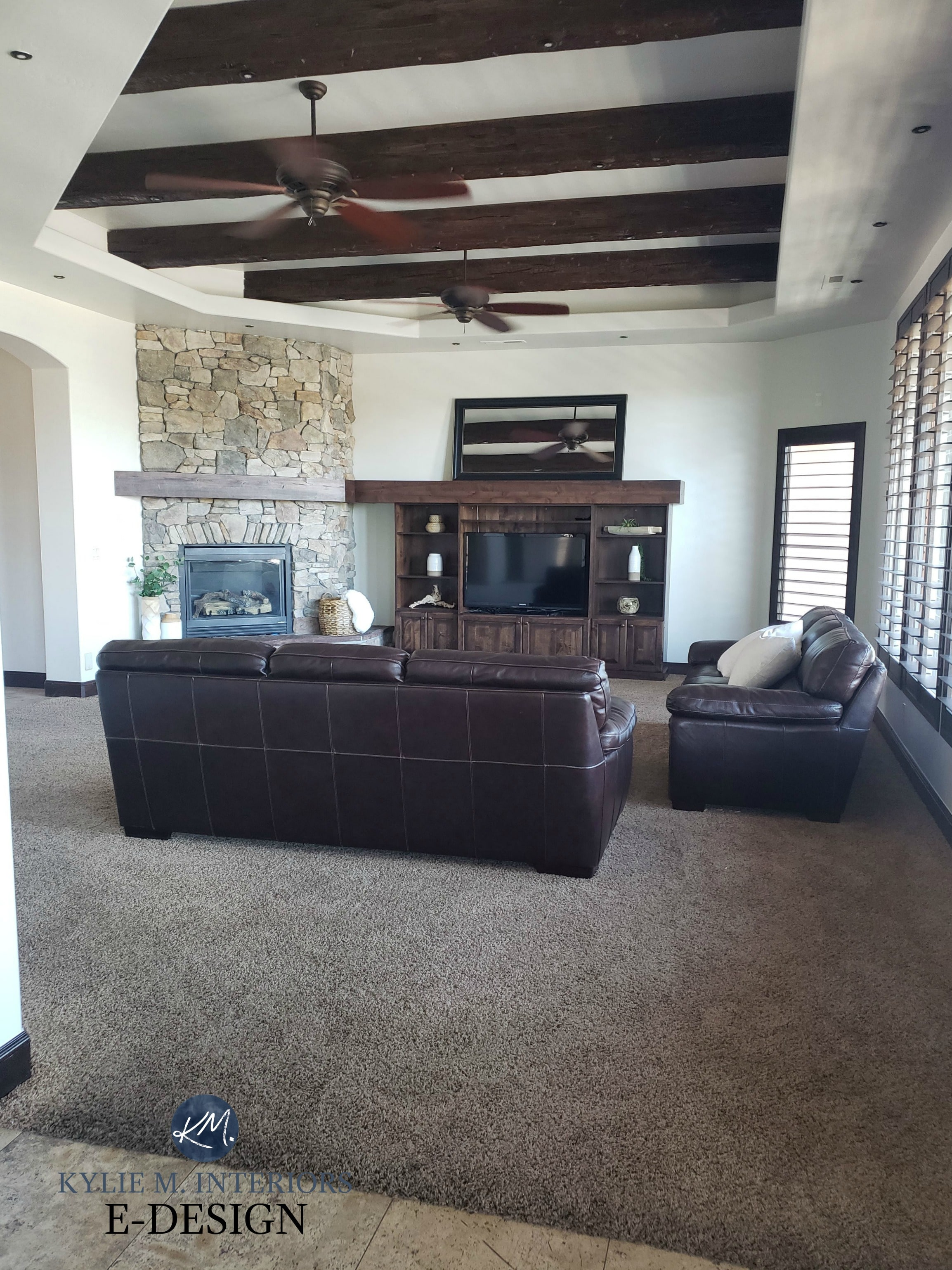 Living room with dark wood beams, trim and tv stand, stone ...