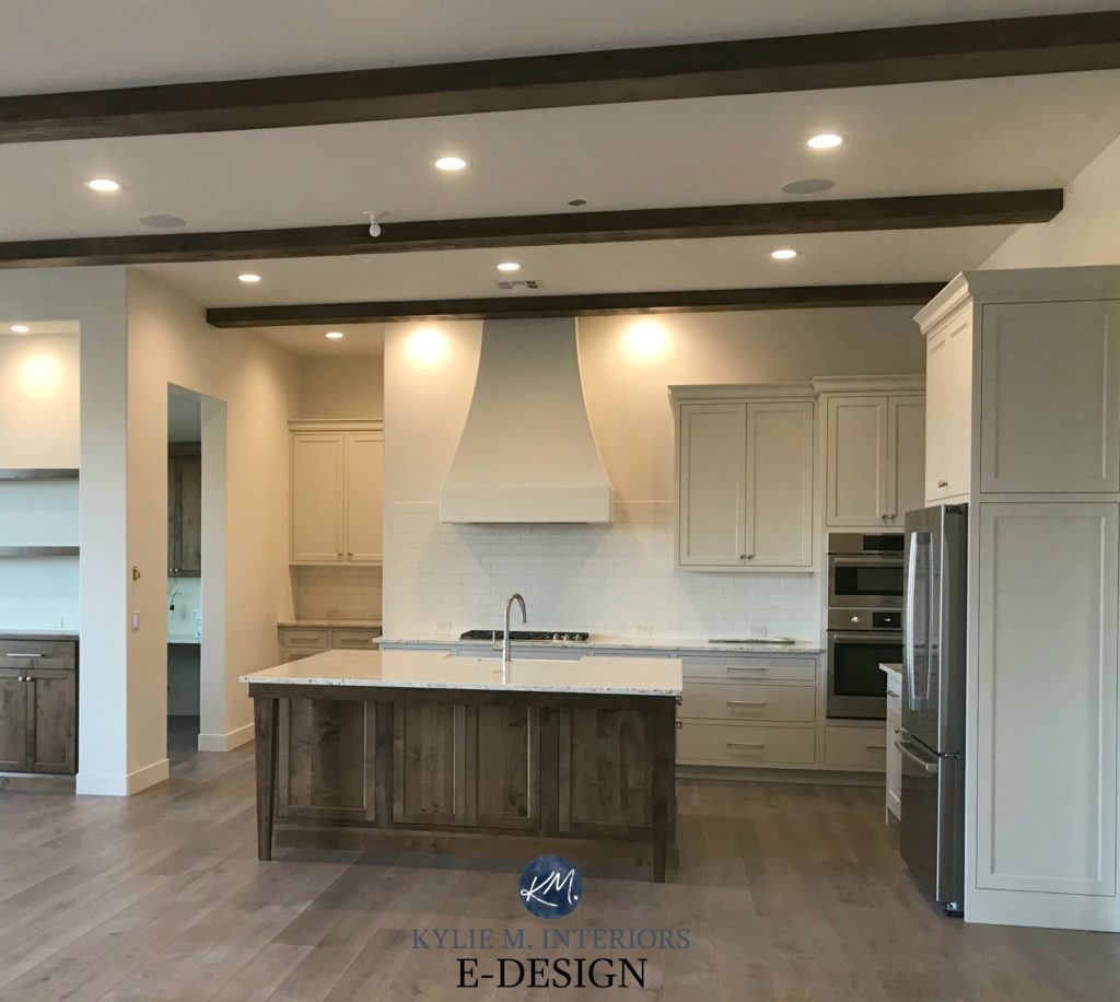 Sherwin Williams White Duck greige cream walls. BEnjamin Moore Edgecomb Gray cabinets, dark wood island, wood beams. Kylie M Interiors Edesign, online paint color blog (1)