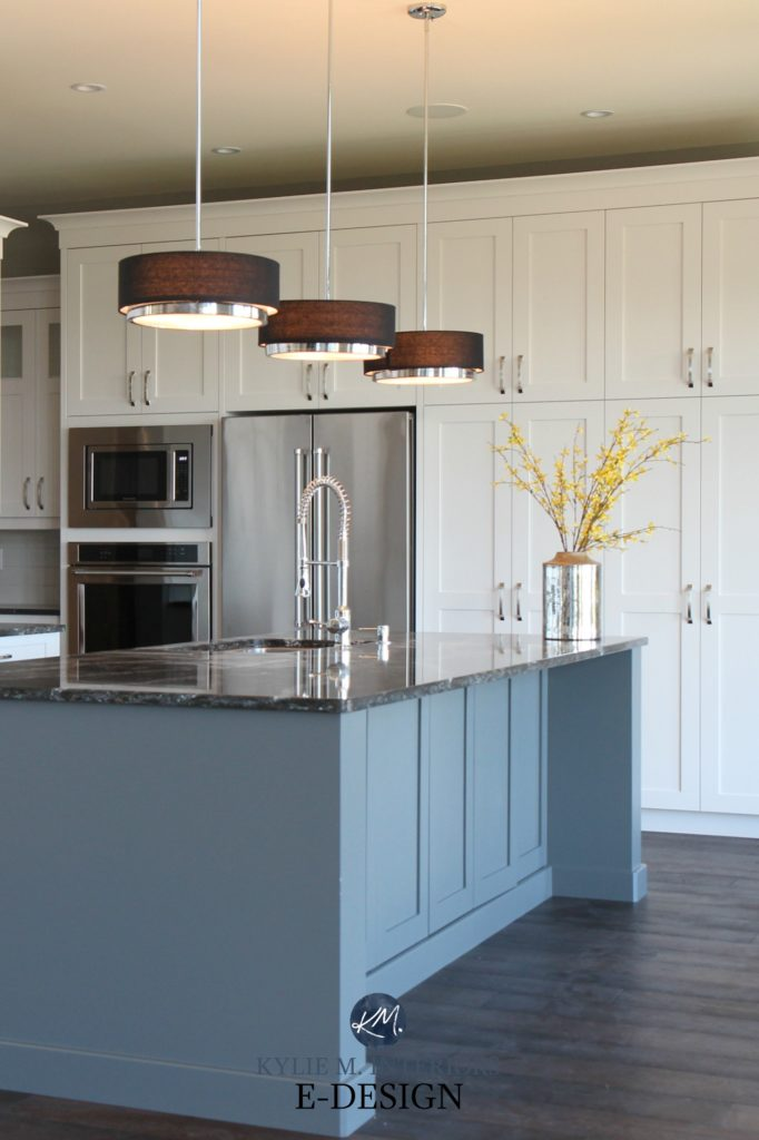 Best white paint colour. Walls or cabinets.White kitchen, gray painted island. Cambria quartz countertop black, dark wood flooring, pendant lights, modern. Kylie M Interiors Edesign. Pure White Sherwin Williams cabinets