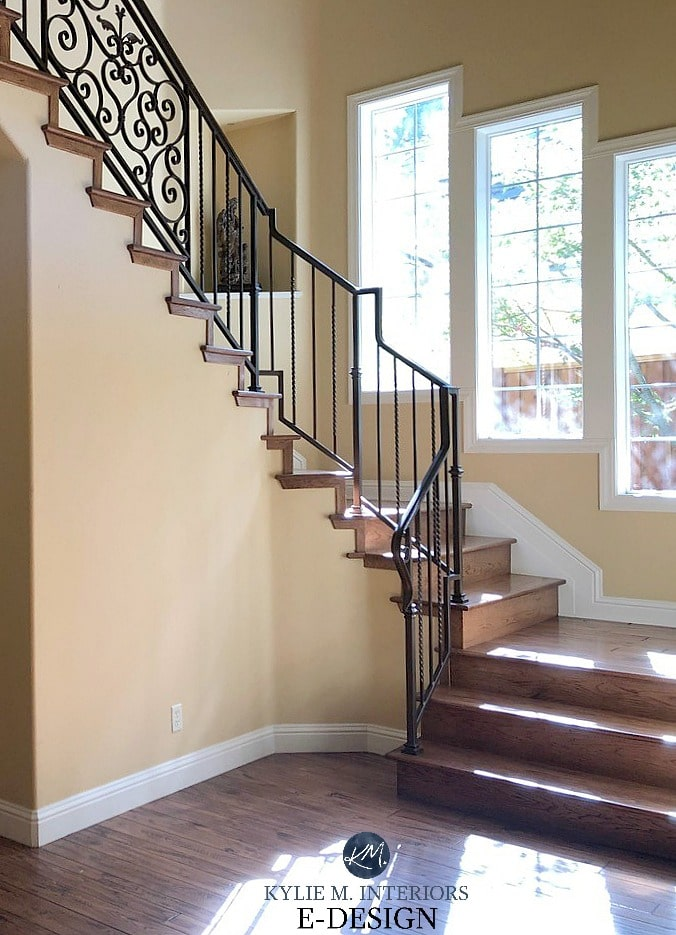 Benjamin Moore Desert Tan walls and Timid White trim in staircase with red oak flooring. Walls need a bit more pink in them. Kylie M Interiors Edesign, online paint color consultant