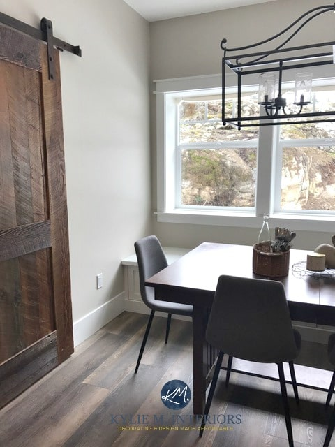 Benjamin Moore Baby Fawn, Edgecomb Gray in dining room, farmhouse style sliding barn door and chandelier. Kylie M INteriors E-design and online color or e-decor blog
