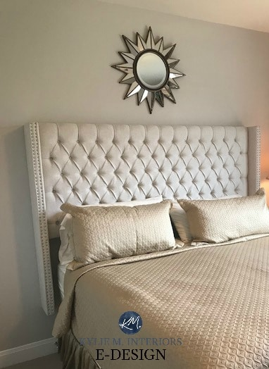 Sherwin Williams Agreeable Gray in bedroom with gold beige bedding