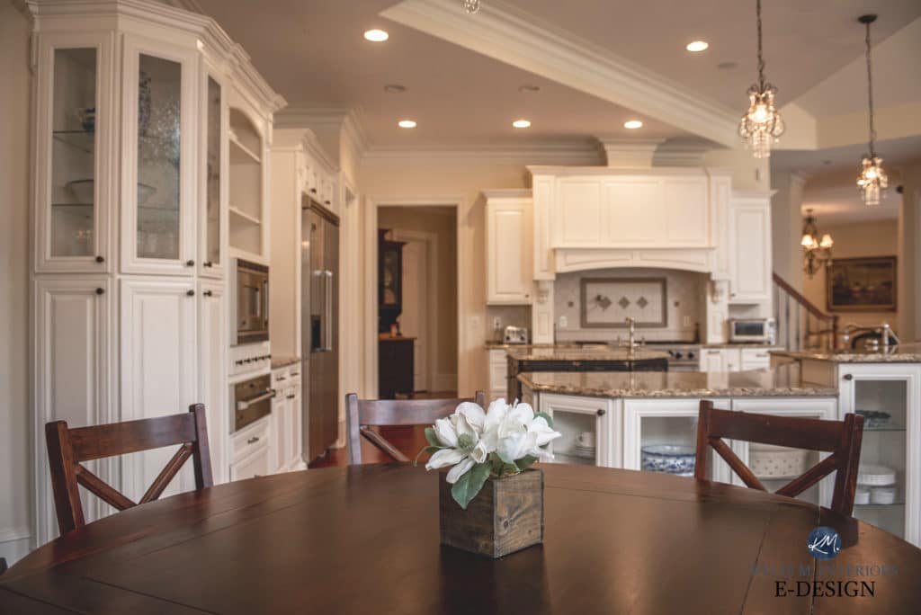 Granite kitchen, maple cabinets painted warm white Sherwin Williams Alabaster. Traditional formal style open layout. Kylie M Interiors Edesign, online paint color advice