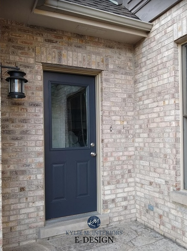 Benjamin Moore Wrought Iron dark navy blue door wtih pink purple brick exterior. Kylie M interiors Edesign, online paint colour consultant and blog