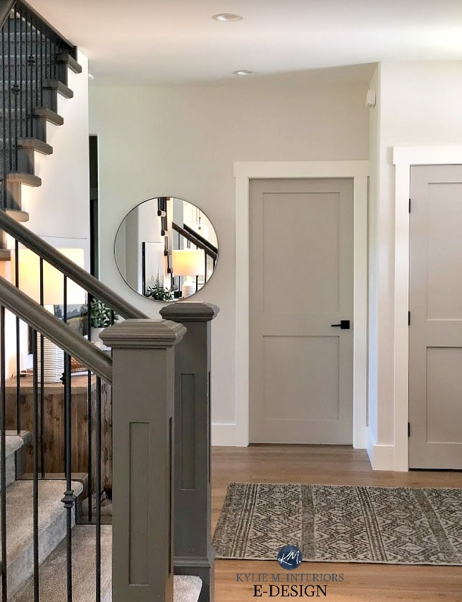 Entryway with Benjamin Moore Edgecomb Gray lightened, Revere Pewter painted doors, white trim, dark painting stair railing. White oak floors. Kylie M Interiors Edesign, online paint color consulting