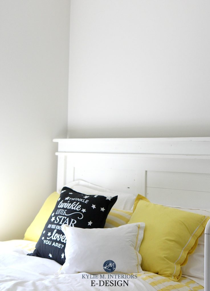 Benjamin Moore Classic Gray with white bedding and yellow and black accents. Warm gray paint colour. Kylie M Interiors Edesign, online paint colour consulting