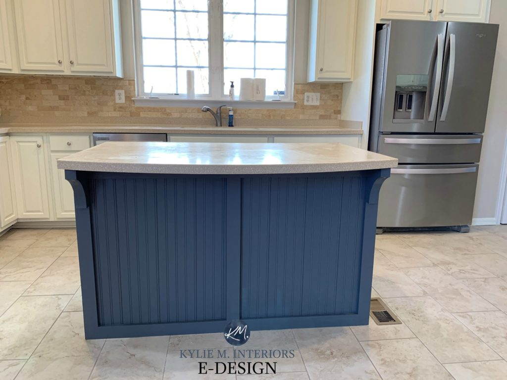 Benjamin Moore Cloud White painted oak cabinets with Ocean Floor navy blue island. Kylie M INteriors Edesign, online paint color consulting