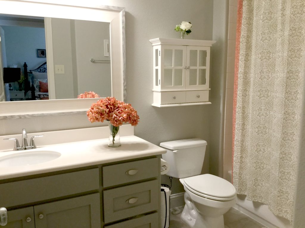Budget friendly affordable bathroom update ideas. Painted vanity, home decor accents, shower curtain. Kylie M Interiors Edesign, online paint color consulting and diy advice
