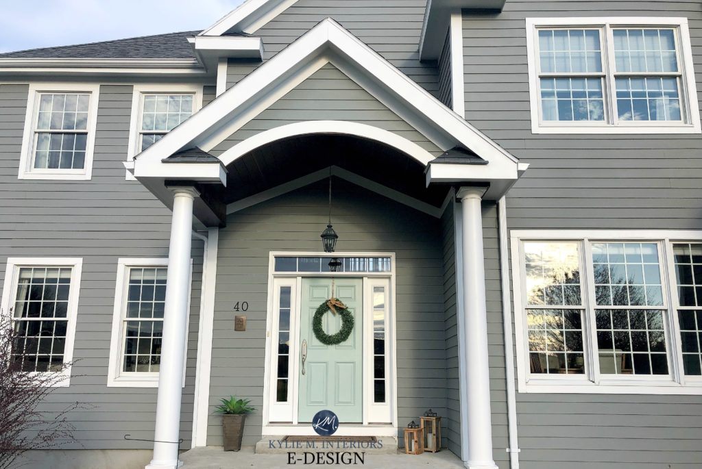 Exterior siding painted Sherwin Williams Classic French Gray with white trim and blue green front door. Kylie M Interiors Edesign, online paint color consulting