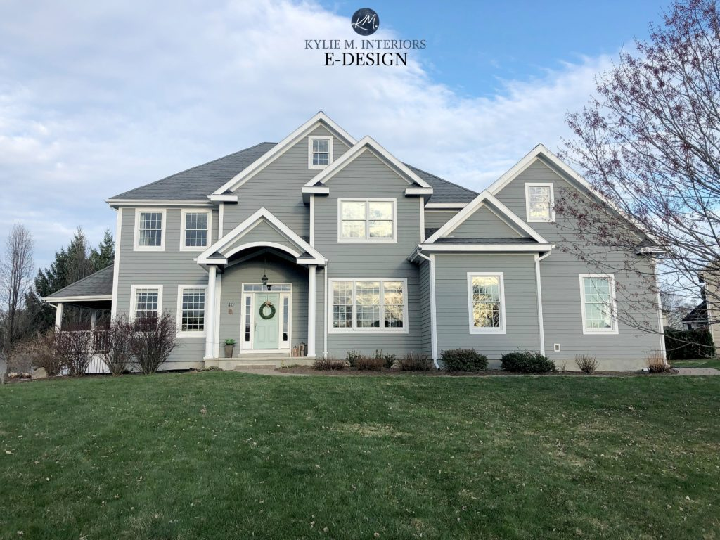 Exterior siding painted Sherwin Williams Classic French Gray with white trim and windows. Blue green front door. Gray roof. Kylie M Interiors Edesign, online paint color consultant and blogger