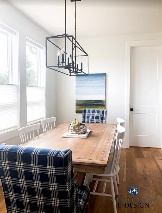 Farmhouse dining room table, Pier 1 chairs. Pure White walls, south facing room. White spindle back chair style from Wayfair. Kylie M Interiors Edesign, online paint colour advice blog