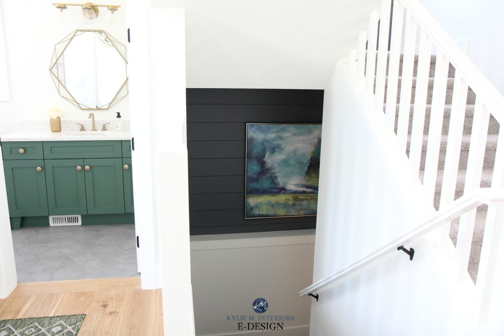 Feature wall in dark staircase using shiplap, art. Powder room with green vanity and walls in Sherwin Williams Pure White. Kylie M Interiors Edesign, online paint colour consulting and advice blog