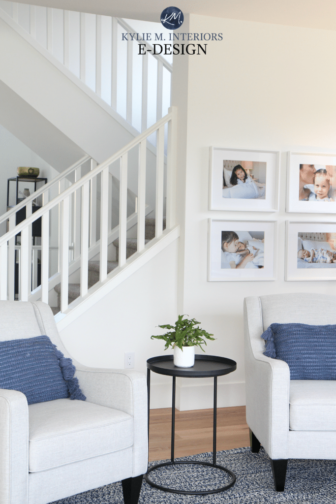 Kylie M Interiors E design, online paint colour consulting. Sherwin Williams Pure White walls, trim and railings in south facing room with open staircase. Navy blue accents and home decor