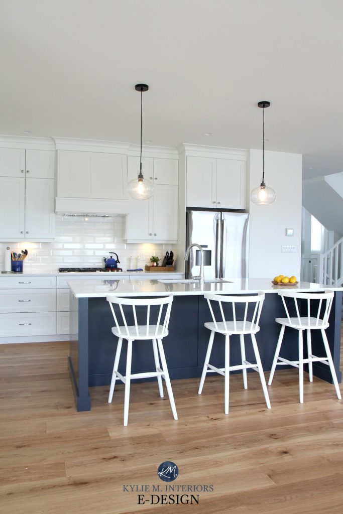 Kylie M Interiors Edesign, online paint colour consultant. Island in navy blue, Cyberspace, Pure White cabinets, bevelled white subway tile backsplash, white cabinets in the kitchen
