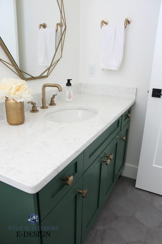 Kylie M Interiors Edesign, powder room with dark gray hexagon tile floor, green painted vanity, gold brass accents, fixtures, mirror. LG Minuet quartz white countertop