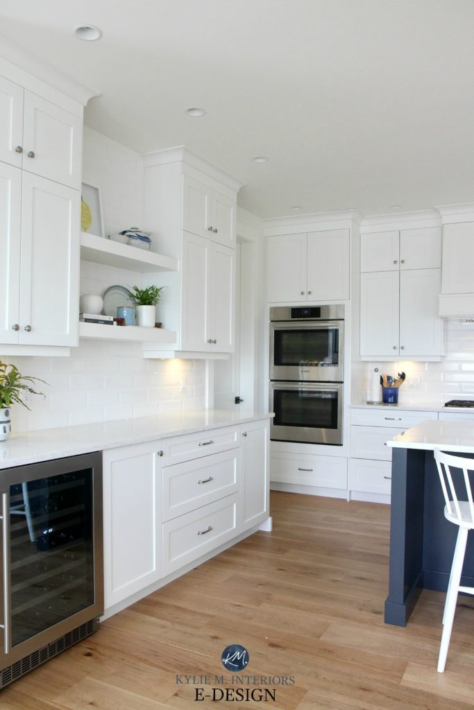 Kylie M Interiors Edesign. Pure White kitchen cabinets, white oak flooring, prep station, wine fridge and floating shelves