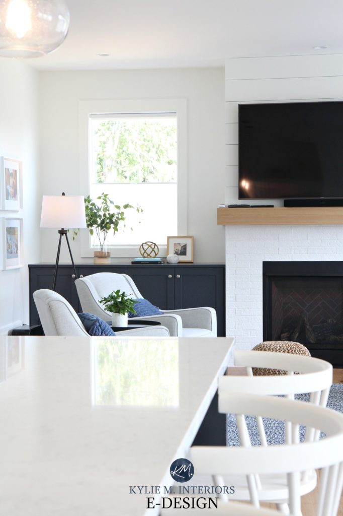 Kylie M Interiors, online paint colour consultant. Living room with shiplap and fake white brick fireplace and tv. Pure White walls and trim, built in cabinet in Cyberspace