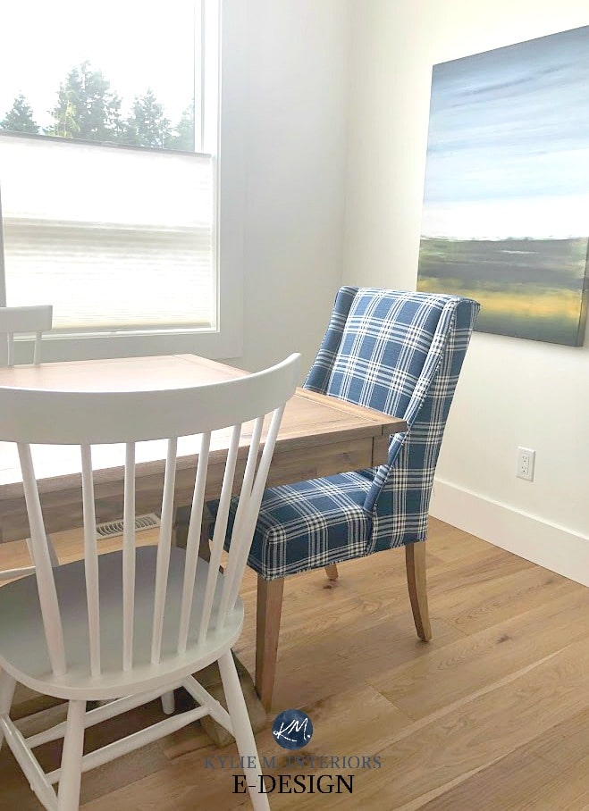 Upholstered blue and white dining chair and white spindle back chair, white oak flooring. Kylie M Interiors Edesign, online paint colour consulting
