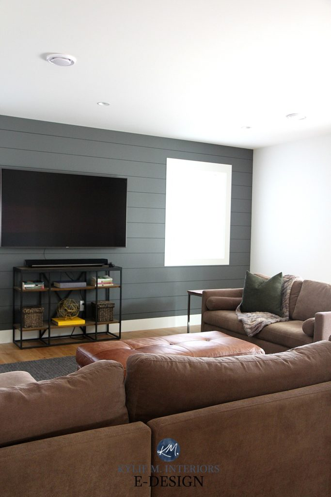 Family room, tv hung on wall, shiplap feature wall Sherwin Williams Grizzle Gray with beige sectional, south facing exposure. Kylie M Interiors Edesign, online paint colour consulting, advice blog