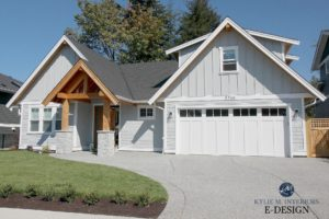 Gray exterior with hardi siding and white trim, garage doors and windows. Wood beams and entryway, board and batten and shakes. Kylie M Interiors Edesign, online paint color consulting