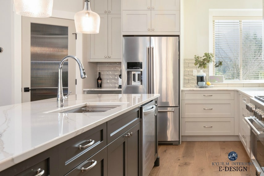 Best warm gray paint colour.Kitchen, gray cabinets, dark painted island, white oak flooring, Brittanica Warm quartz countertop. Kylie M Interiors Edesign, online paint colour blog. Benjamin Moore