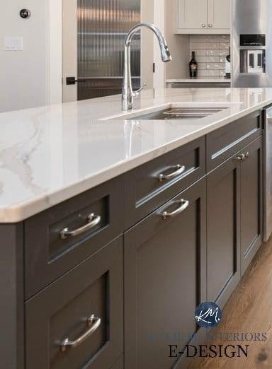 Kitchen island painted dark gray green, Brittanica Warm quartz countertop, warm gray cabinets. Kylie M Interiors Edesign, online paint color advice