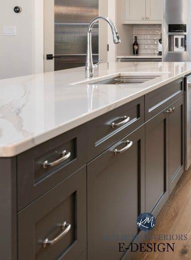 Kitchen island painted dark gray green, Brittanica Warm quartz countertop, warm gray cabinets. Kylie M Interiors Edesign, online paint color advice
