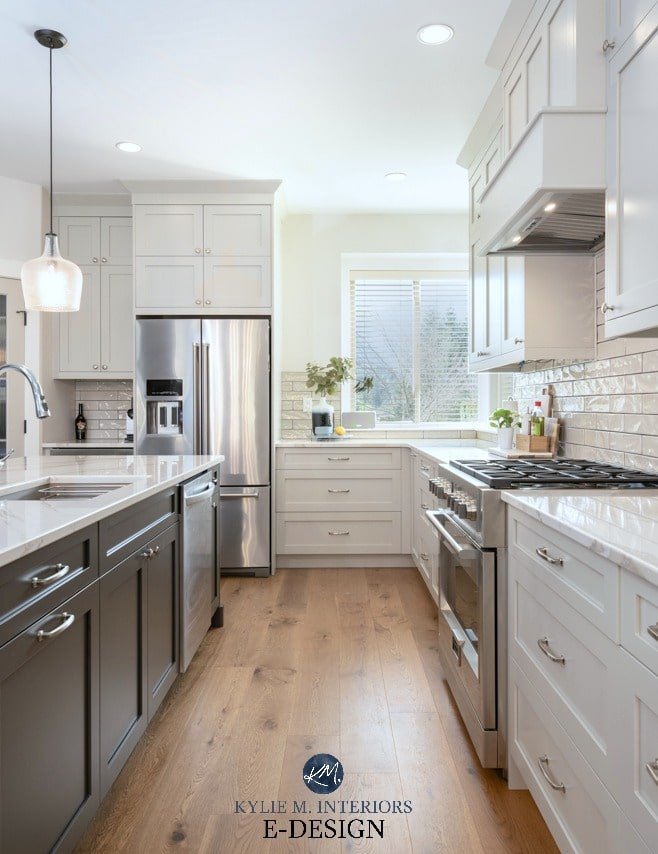 Kitchen with warm gray, Benjamin Moore Revere Pewter cabinets and Sherwin Williams Urbane Bronze painted island. White oak wood flooring. Kylie M Interiors Edesign, blog and colour advice online