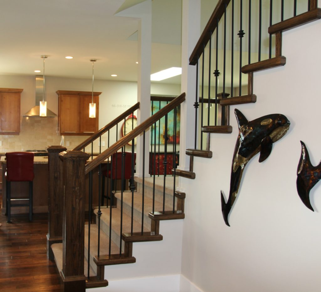 Staircase in entryway with painted hand railing and carpet on stairs. White oak flooring and open to kitchen. Kylie M Interiors Edesign, online paint colour advice blog and consulting