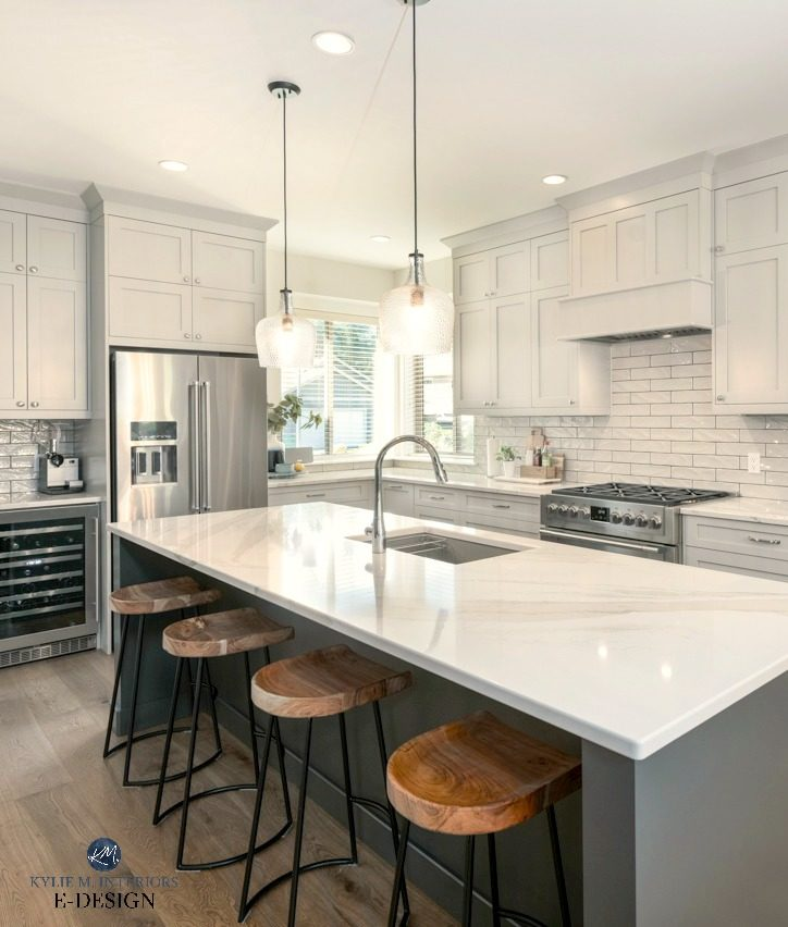 Kitchen island painted a dark gray green with Brittanica Warm quartz countertop, warm gray cabinets and subway tile backsplash. Kylie M Interiors Edesign, online paint color consultant