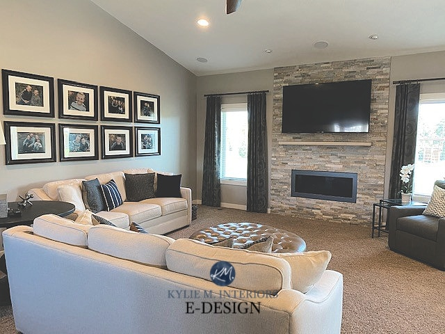 Anew Gray living room, stacked ledgestone fireplace, gallery wall, beige carpet. Kylie M Interiors Edesign, online paint color consulting and blog advice