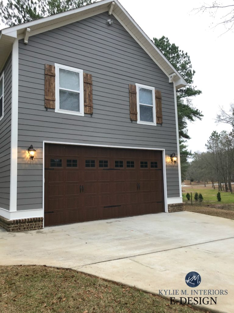 Exterior siding, Sherwin Williams Gauntlet Gray, Pure White trim, brown brick, wood shutters minwax. Kylie M Interiors Edesign, online paint color coach advice