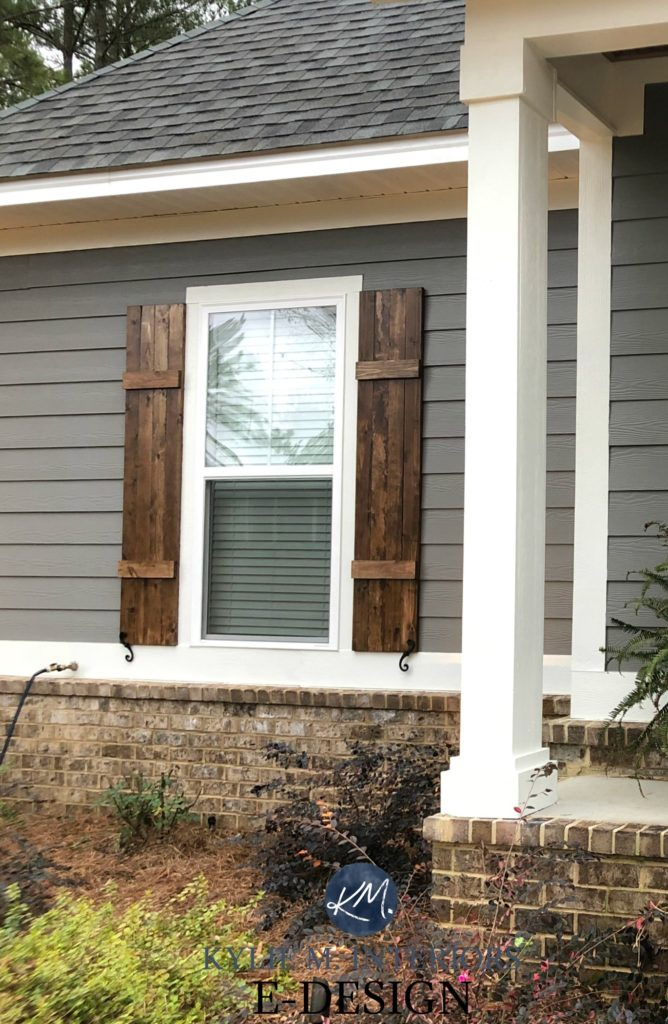 Exterior siding, Sherwin Williams Gauntlet Gray, Pure White trim, brown brick, wood shutters minwax. Kylie M Interiors Edesign, online paint colour coach advice