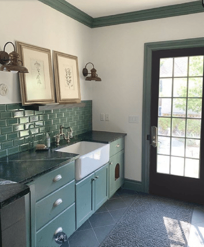 Green painted wood cabinet in laundry and mud room. White Dove walls, slate flooring. Soapstone countertop. Kylie M Interiors Edesign, online paint color blog DIY