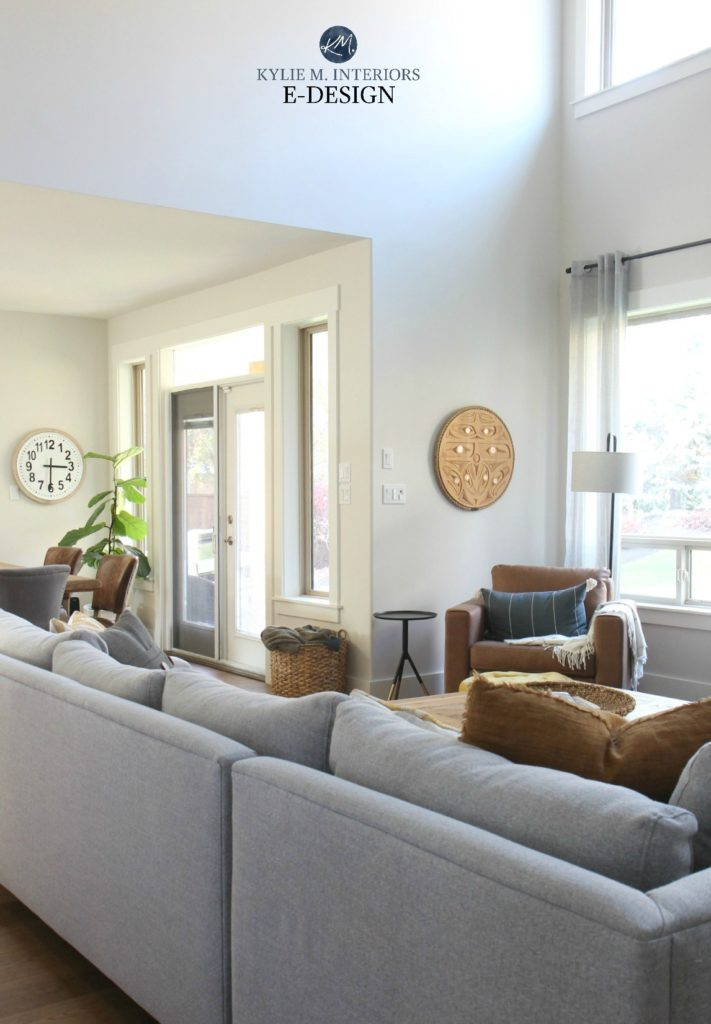 Kylie M Interiors Edesign, online paint blog. Tall, 2 storey open concept living room with vaulted ceiling, greige walls. Gray sectional